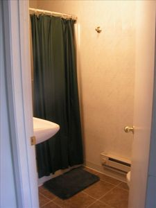 2nd smaller bath on main floor near 2nd bedroom & stairs