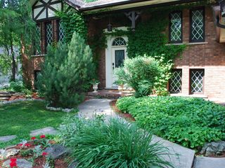 Niagara-on-the-Lake house photo - Amberlea House is surrounded by a mature garden and covered partially in Ivy. a