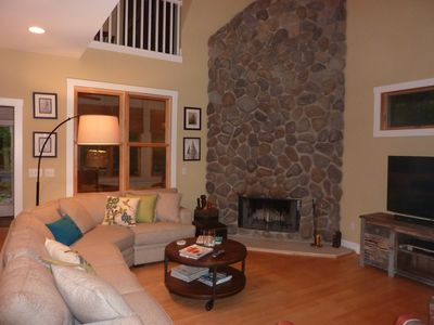 Family room with fireplace with gas starter.
