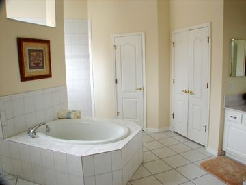 Master en-suite bathroom with center bath & shower