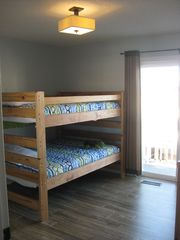 Carolina Beach condo photo - Guest bedroom with full-over-full bunk beds