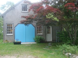 Chatham house photo - Barn -- with bedroom, clawfoot tub, kitchen, living area, deck