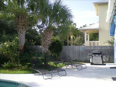 Great pool deck with chairs, BBQ and room to play!