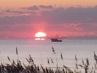 Isle of Palms condo photo - Enjoy this sunset and your beach vacation in Isle of Palms - come - stay - play.
