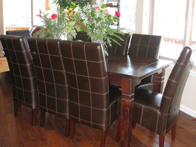 Dining area with table that has two leaves