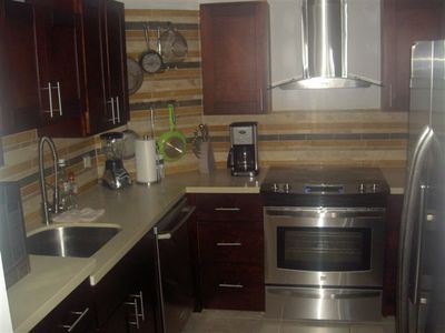 Quartz Countertops, Gallery Style Appliances, nothing cheap about this kitchen!