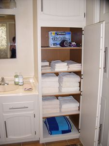 Bathroom cabinet showing all towels, etc.