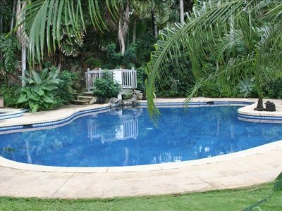 Luscious flora surround pool