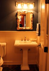 Somers house photo - The Power Room mirror is made from shells we collected from around the world.