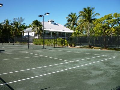 Clay tennis courts and Courtside Steakhouse