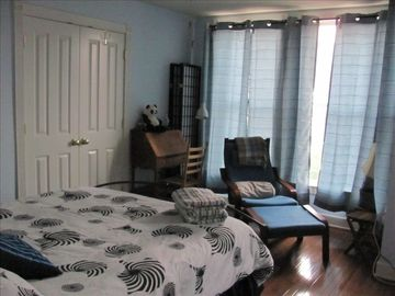 queen-sized bed, sitting area and daybed in second bedroom. . .