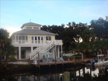 Crystal River house rental - view from across canal. Dock has room for 3 full size boats