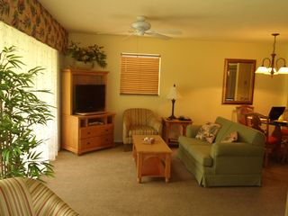 Living room opens to lanai - North Naples condo vacation rental photo