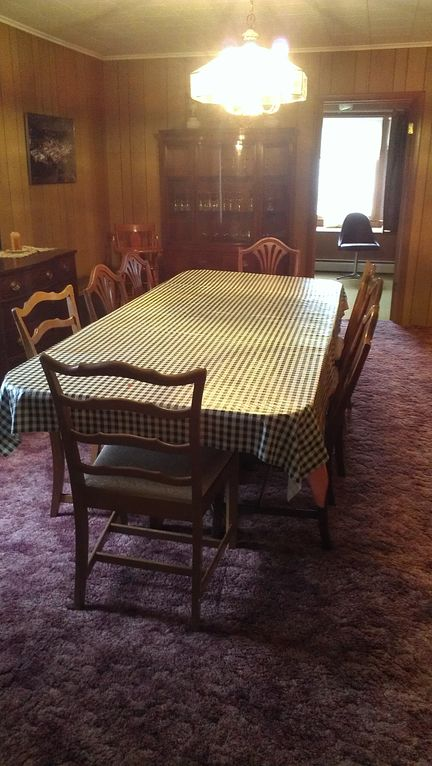 Dining room with china cabinet. Seats 8 or 10 if you are friends.
