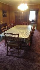 Lake Placid house photo - Dining room with china cabinet. Seats 8 or 10 if you are friends.