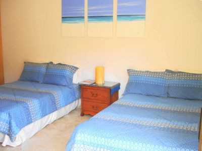 spacious 2nd bedroom with 2 double beds, ocean view.