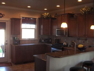 View ~ Custom Kitchen with Slab Granite