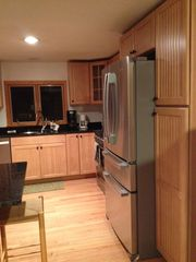 North Conway condo photo - New granite kitchen with stainless steel appliances.