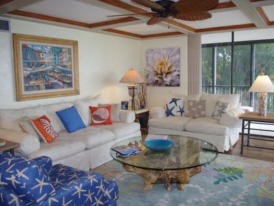 The living room has a beautiful gulf view,  and seats 6 - 8 comfortably.