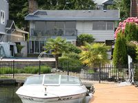 2-story Lake Front Home With A Swimming Pool, Sun Room, Boat Dock, And Balcony