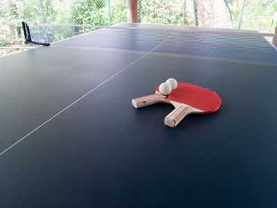 Start up a game of Ping Pong in a covered area behind the Rancho.