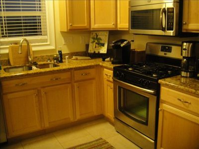 Full kitchen with stainless appliances and gas stove