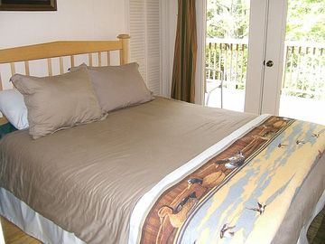 Third bedroom with queen bed and private deck