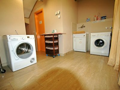 Laundry: washing machine, dryer, iron and ironing board