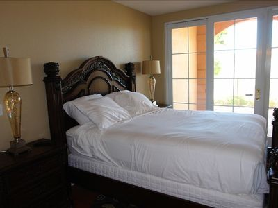 Henderson condo rental - Master bedroom w/ private patio. Duvet cover to come! TV faces bed.