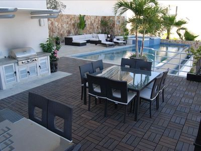 Large Deck and Grill Area with Infinity Pool and Lounge Chairs with vasts views