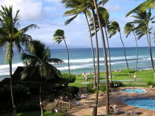 View of the island of Molakai, ocean & pool and hot tub - Lahaina condo vacation rental photo