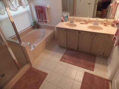 MASTER BATH WITH ROMAN TUB HUGE WALKIN CLOSET AND LARGE SHOWER PRIVATE TOLIET