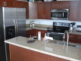 Warm Beach house photo - Kitchen Contains Ice Maker and Cold Water from the Fridge