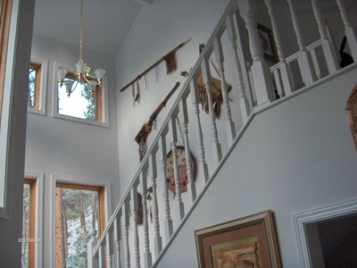 Stairs and warrior wall leading up to bedrooms