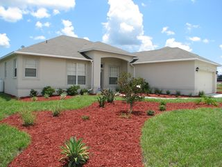 Wildflower Ridge villa photo - Large yard and gardens with Florida Friendly landscaping