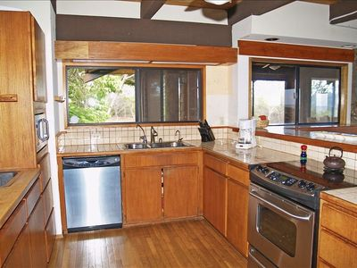Complete Kitchen with upgraded stainless appliances and view of the beach!