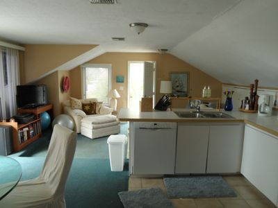 one bedroom apartment upstairs kitchen and dining There is a stack washer/dryer
