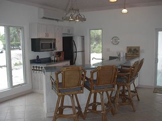 Governor's Harbour house photo - Enjoy cooking in the fully equipped kitchen with seating at the counter.