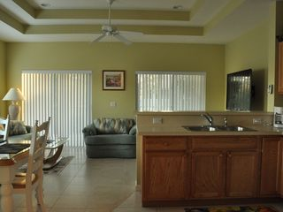 Port St. Lucie condo photo - Living and Dining areas. Doors lead to Screened in Balcony.