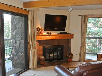Family room opens to balcony overlooking Sawmill Creek & Four O'Clock Run.