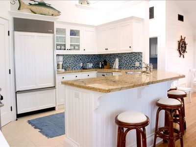 Gourmet kitchen with granite top and top of the line appliances.