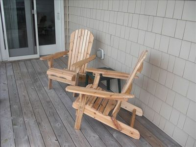 Balcony overlooks pool. Sara made these Adirondack chairs from a kit!
