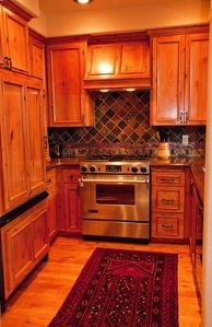 Kitchen has alder cabinets, granite countertops and stainless steel appliances.