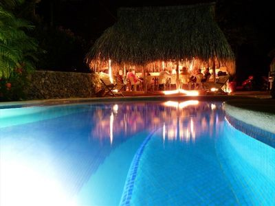 The pool side champa is perfect for an evening meal in tropical comfort