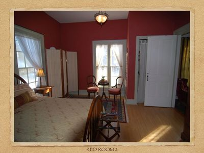 Red bedroom with queen bed AC and TV