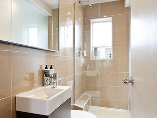 Islington apartment photo - Bathroom, tiled, with large mirrors and walky-in shower. Natural light, towels