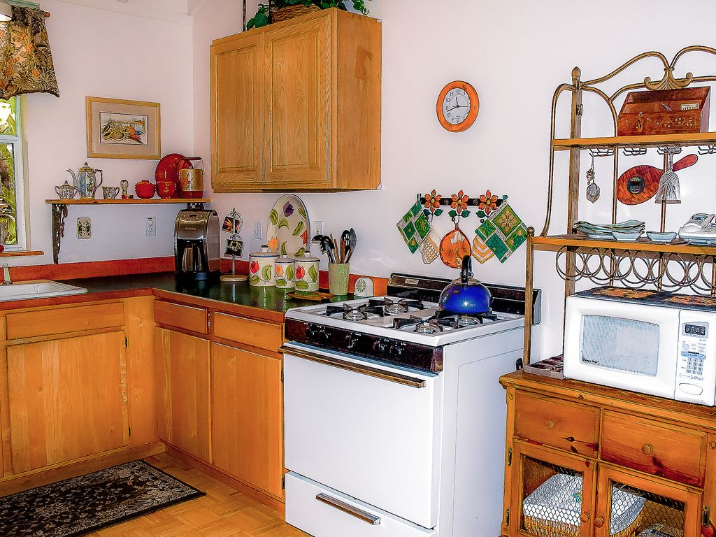 Fully equipped kitchen with all the amenities to cook up a fabulous meal.