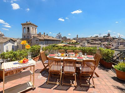 Panoramic terrace: dine 'al fresco' amidst views of Rome's domes and sights.