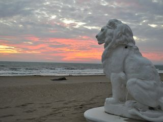 Cabarete villa photo - One Of Villa Leone's Two 2 Ton Lions Watches The Sunrise.