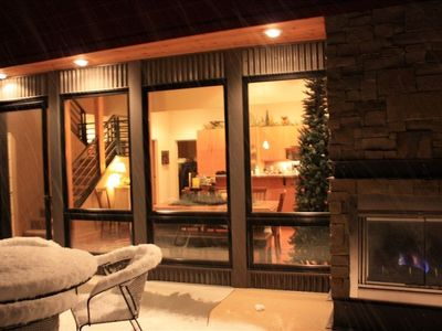 Red Lodge villa rental - Patio area with outdoor fireplace looking in on Kitchen Dining Great Room area!